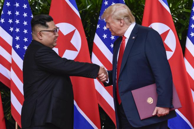 Trump Kim Summit Pyongyang Reacts <YONHAP NO-3533> (AP)