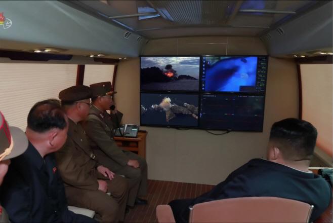 북한TV, '신형 대구경조종방사포 시험사격' 보도