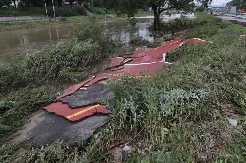 폭우에 유실된 자전거 도로<YONHAP NO-2975>