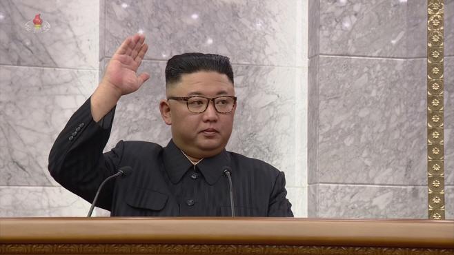 북한 노동당 전원회의서 거수하는 김정은