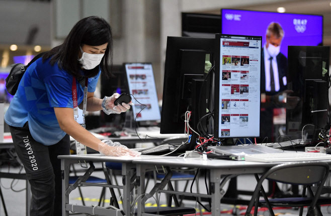 OLY-2020-2021-TOKYO-MEDIA <YONHAP NO-3140> (AFP)